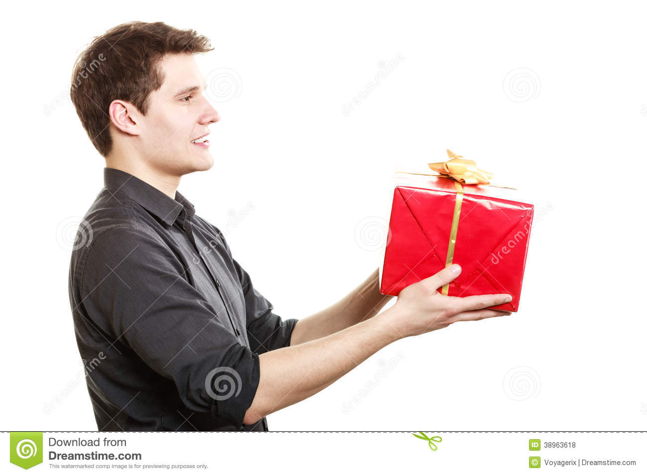 Holiday. Man Giving Gift Box With Golden Ribbon Stock