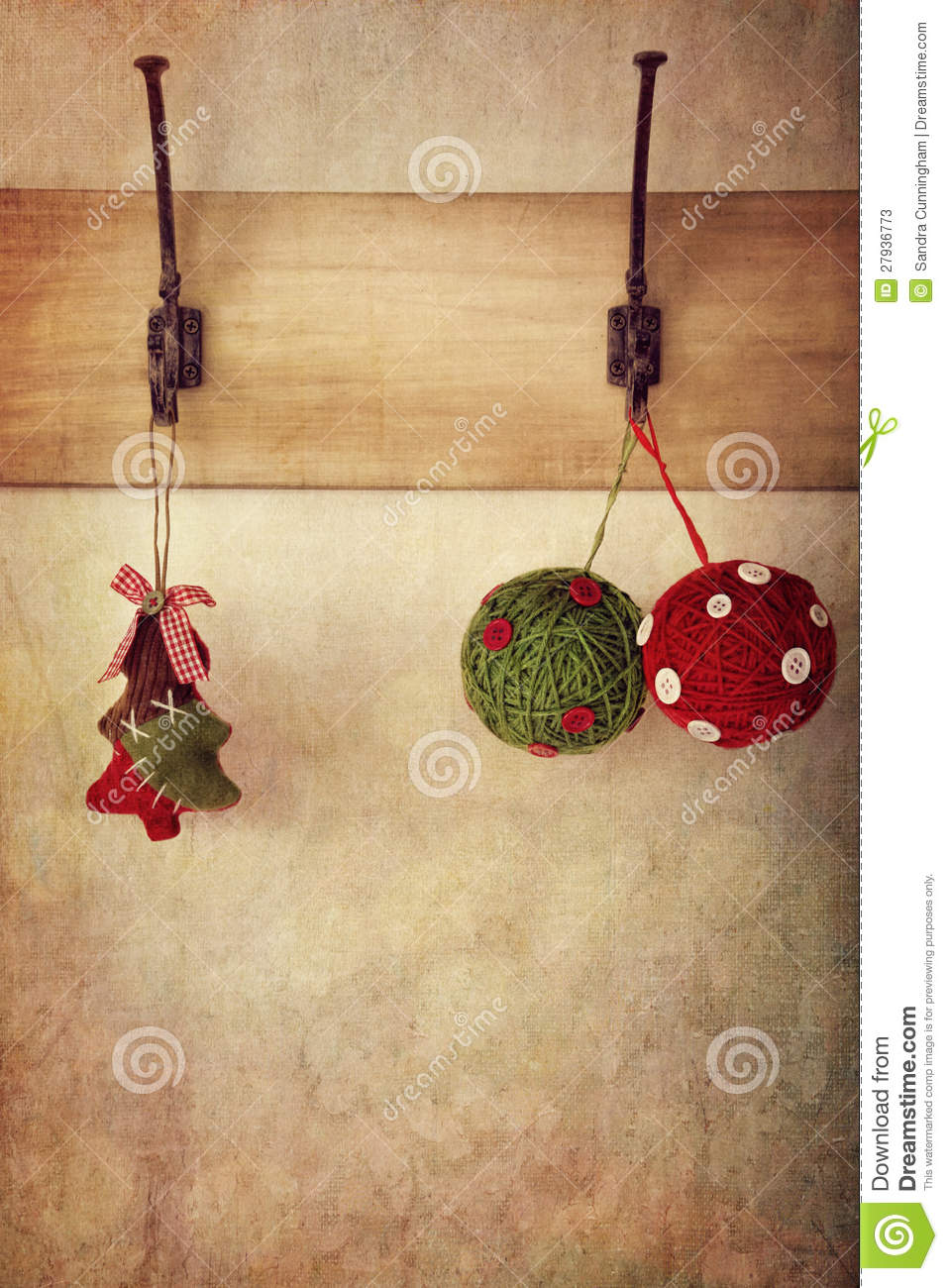 Holiday ornaments hanging on antique wall hooks stock