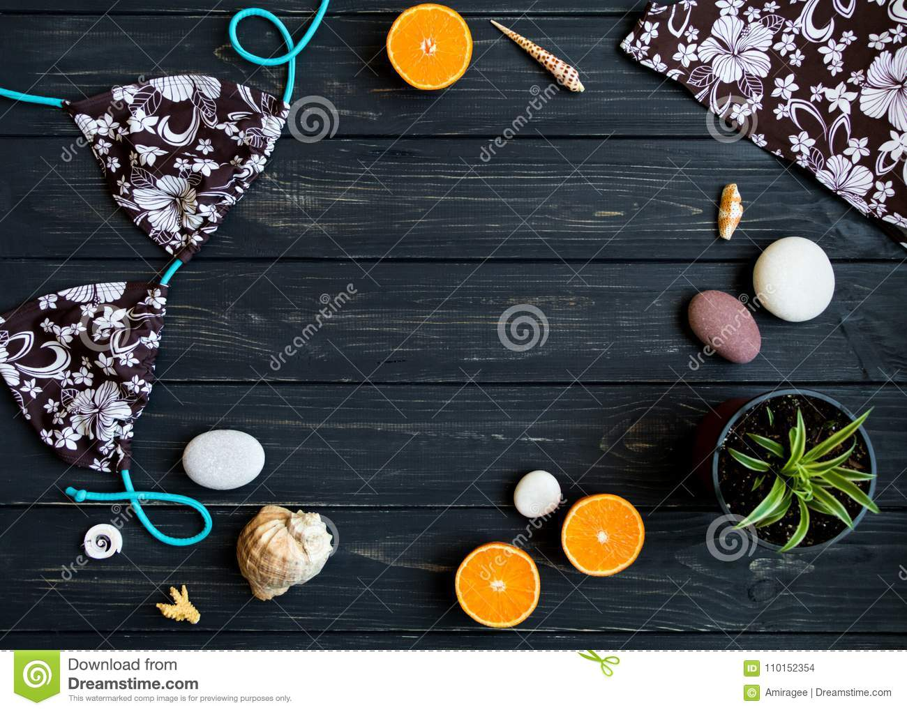 Holiday elements: swimsuit, stones, seashells, fruits. Travel photo, flat lay, top view