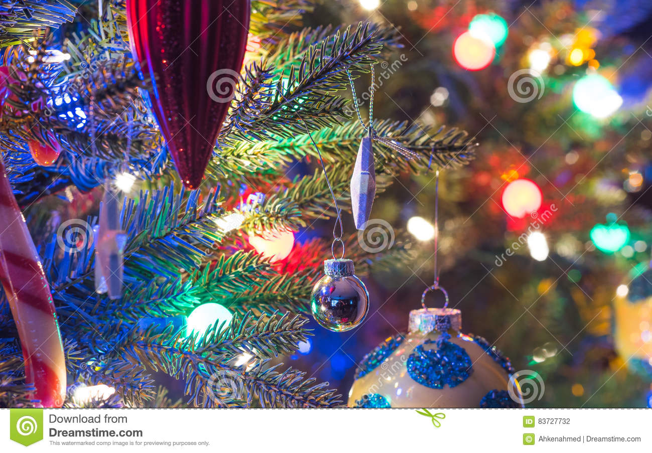 Holiday Season Christmas Tree Decorations Glow Under Luminous And Vivid Colorful Lights On A Small Faux Indoor Tree Stock Photo Image Of Hanging Bright 83727732