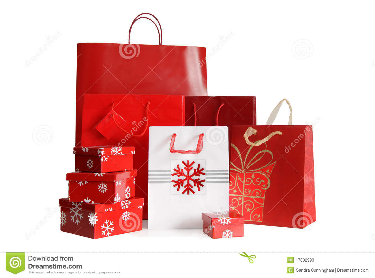 Holiday shopping bags and gift boxes on white stock image
