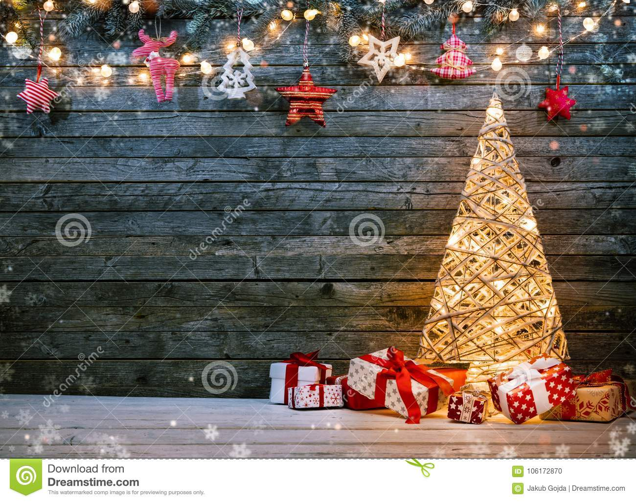 Holidays background with illuminated Christmas tree, gifts and d
