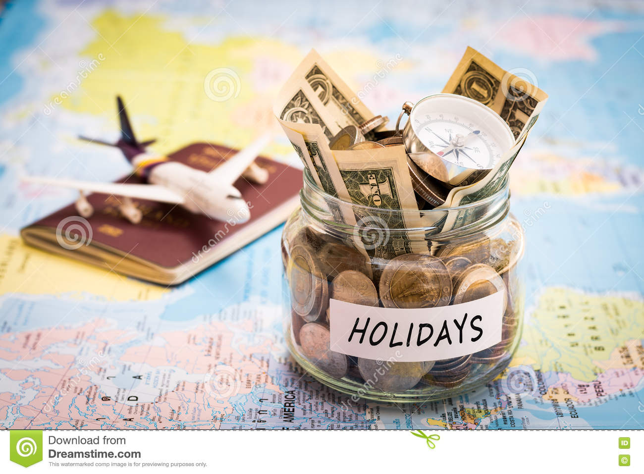 Holidays budget concept with compass passport and aircraft toy royalty free stock photo gumiabroncs Images
