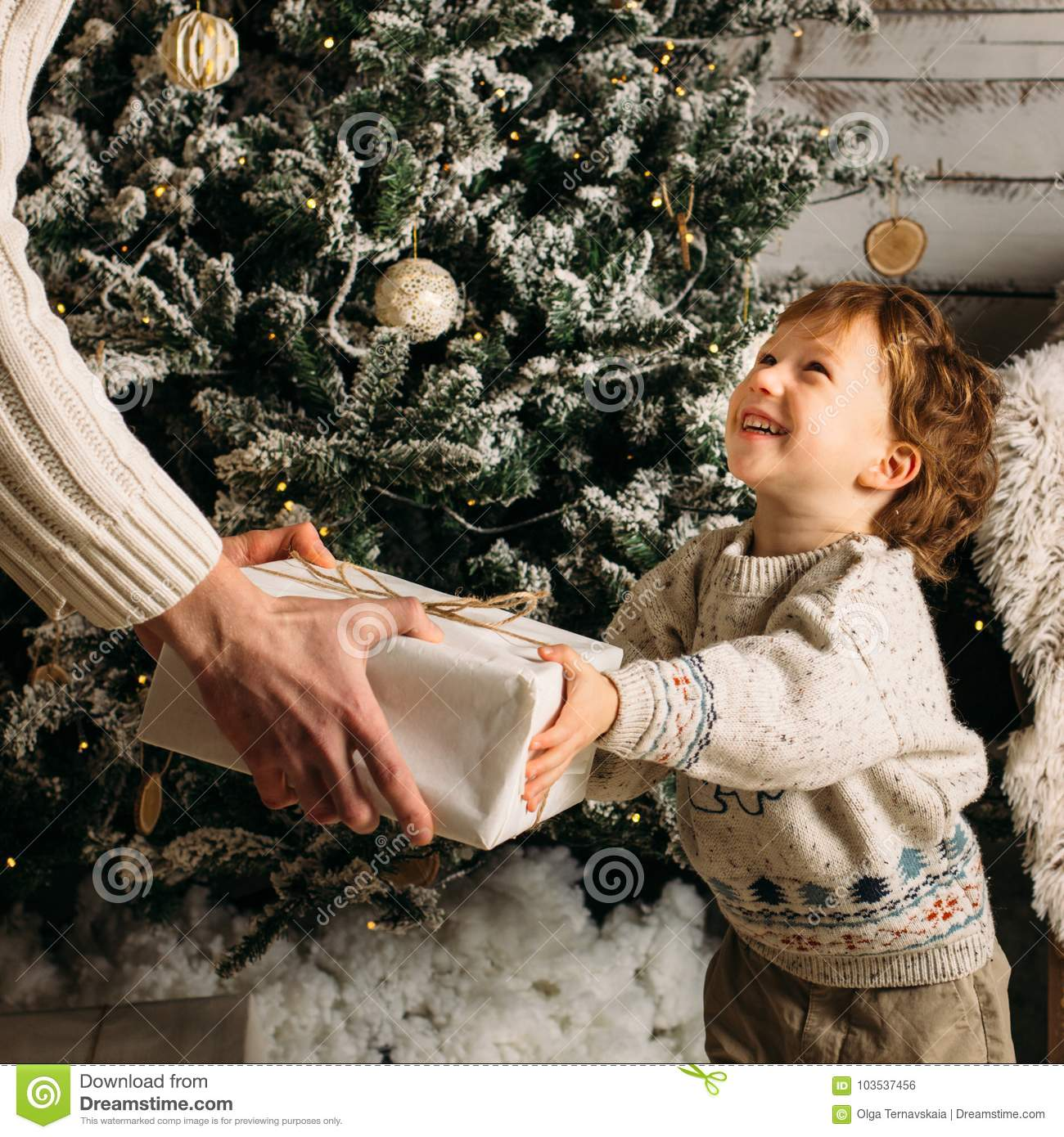 Holidays, christmas, family and happiness concept - close up of father and son with gift box. Smiling little blonde