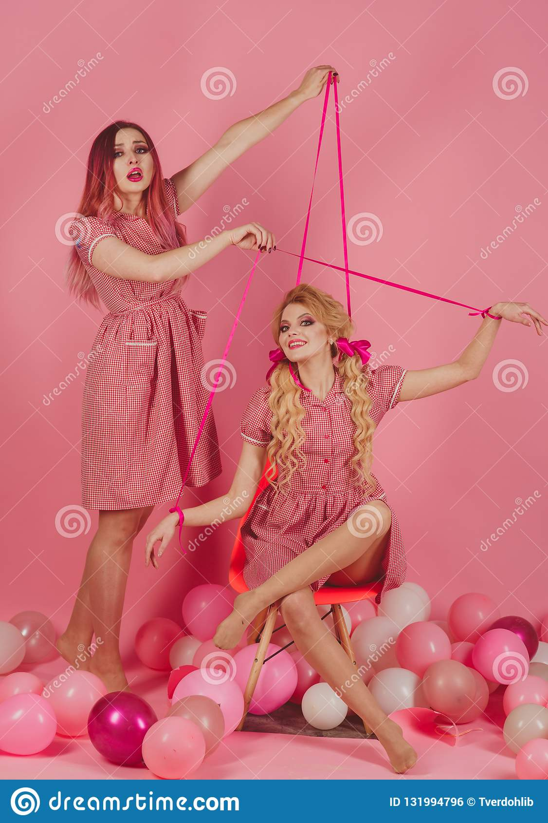 Holidays and dolls. Creative idea. Funny advertising. retro girls in party balloons. vintage fashion women puppet. Crazy