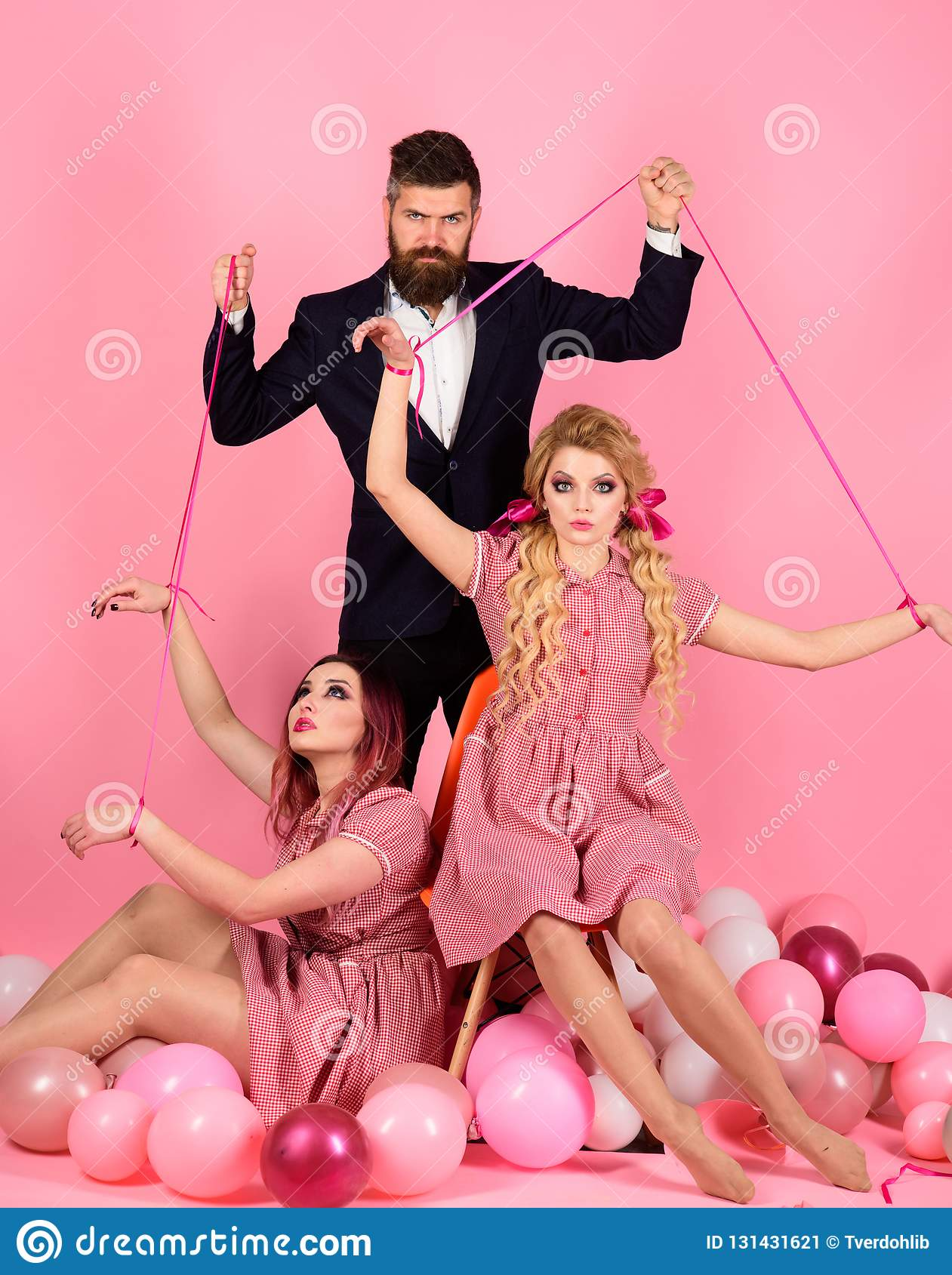 Holidays and dolls. dominance and dependence. Creative idea. Love triangle. retro girls and master in party balloons