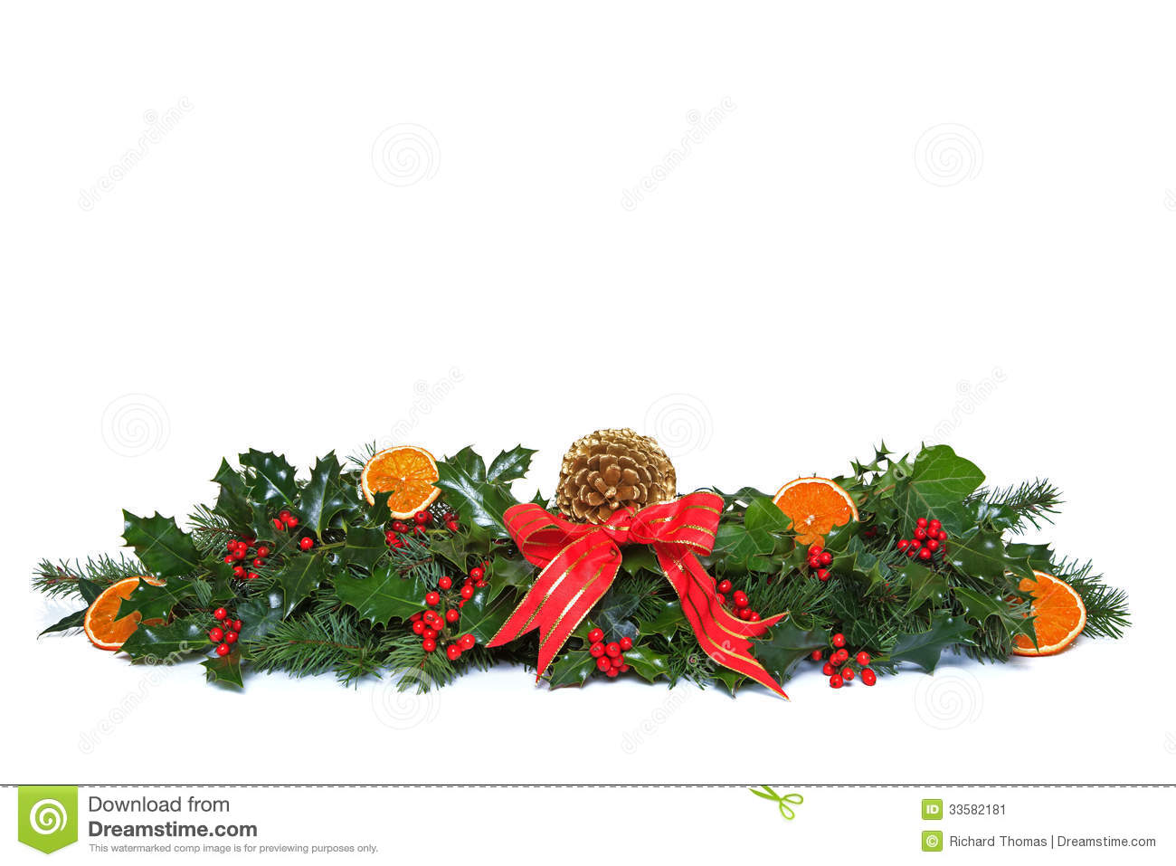 Traditional christmas garland made from fresh holly with red berries