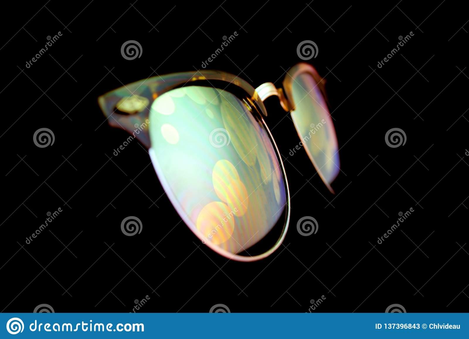 Holographic screen reflection on sunglasses in the night