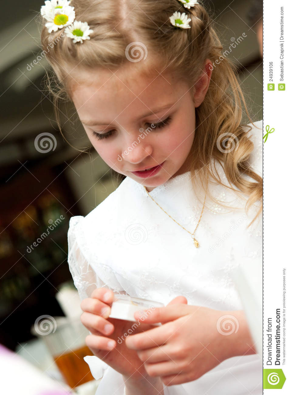 Young girl has received her first holy communion gift.