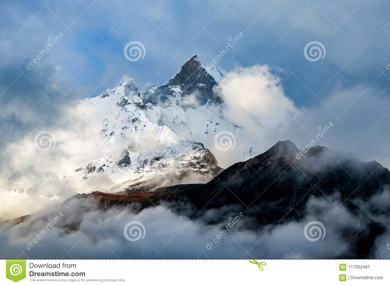 Machapuchare, Fish Tail Mountain rising above the clouds from the Annapurna base camp trail, Nepal