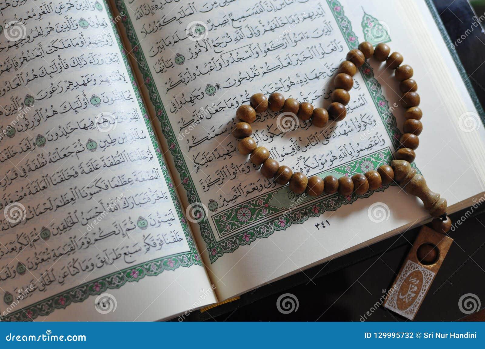 holy quran tasbih rosary beads holy quran tasbih rosary beads blur background 129995732