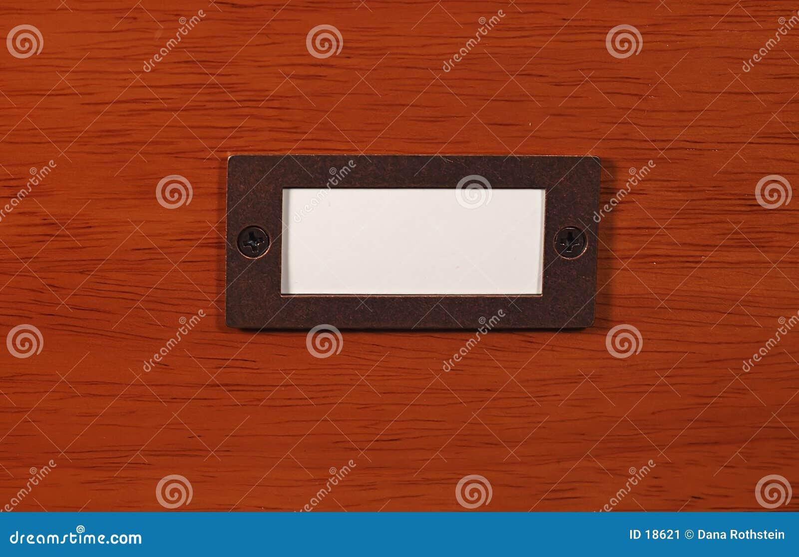 Holz mit Namensschild