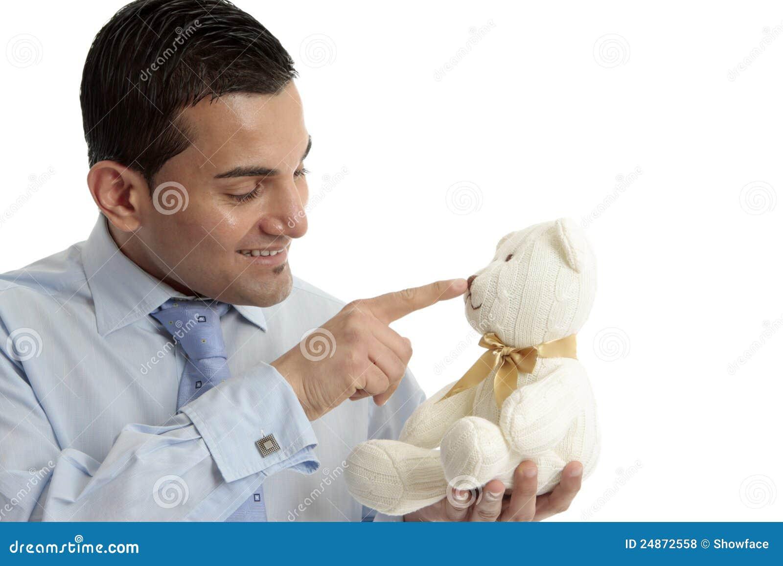 Hombre Con El Oso De Peluche Foto de archivo - Imagen de feliz ...