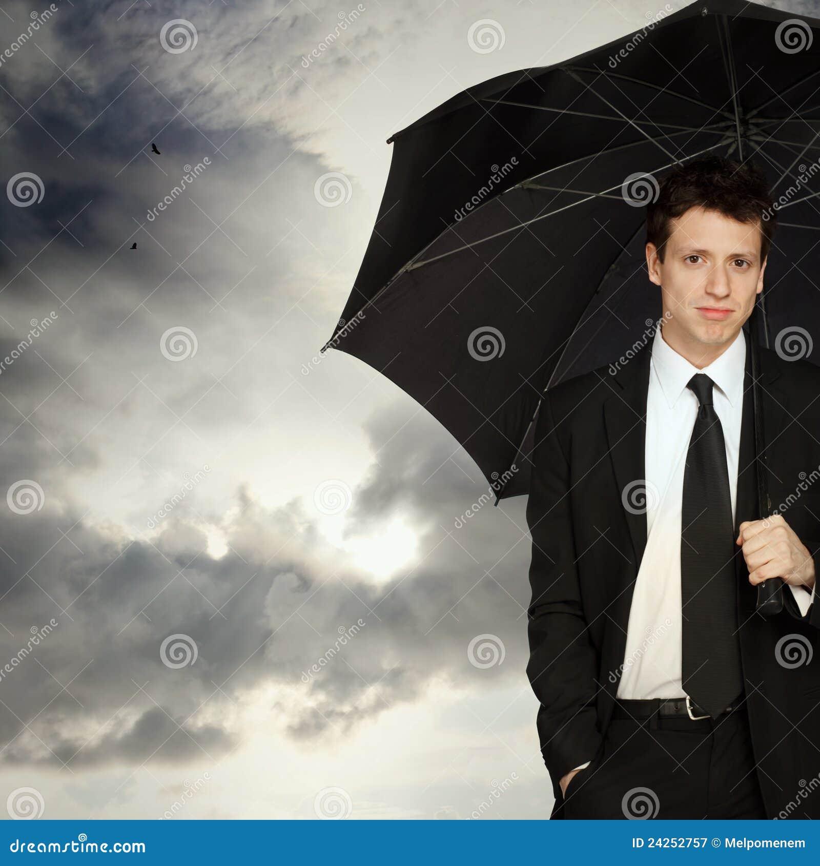 Hombre con estilo con el paraguas