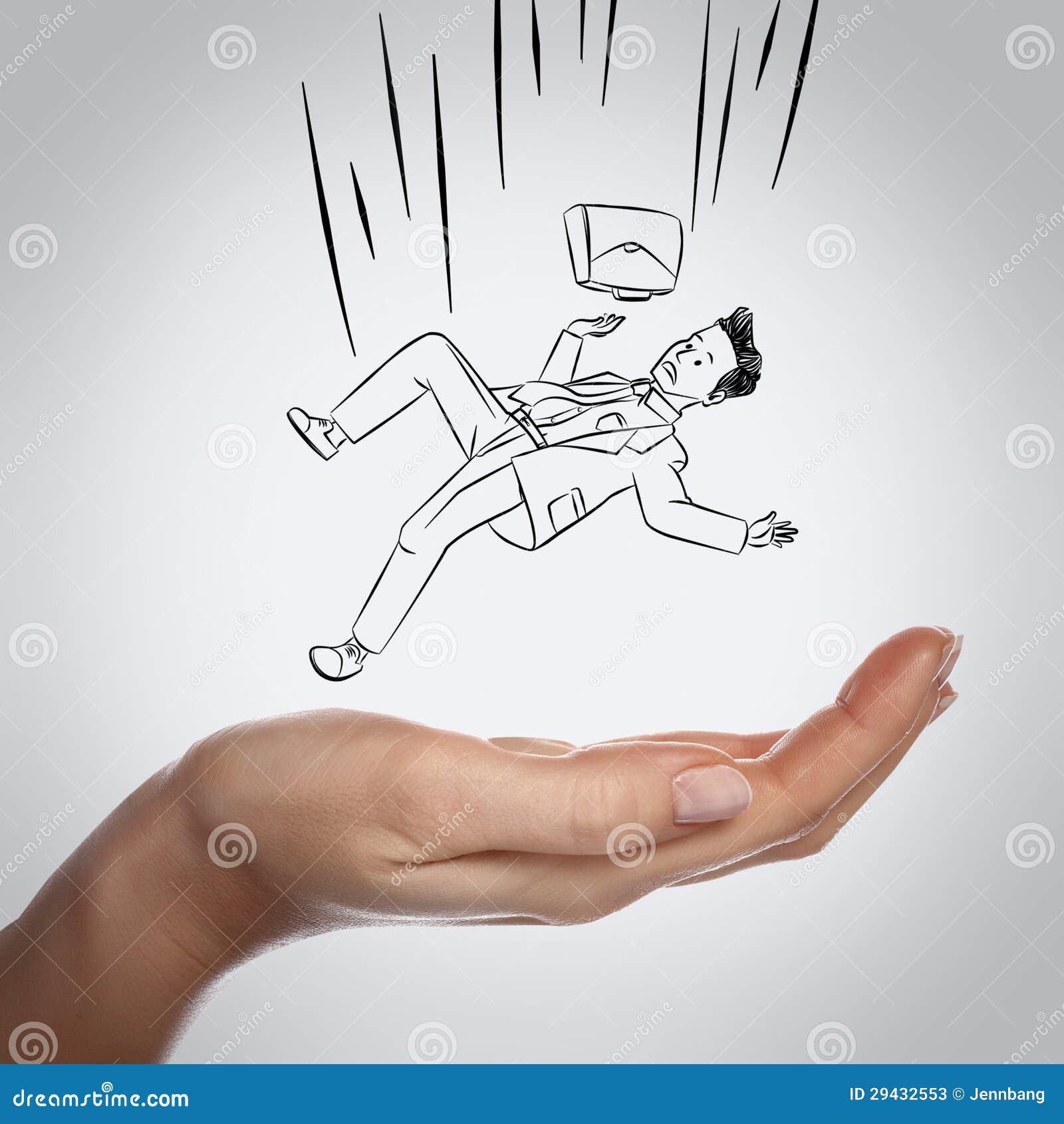 Hombre de negocios que cae abajo en la mano