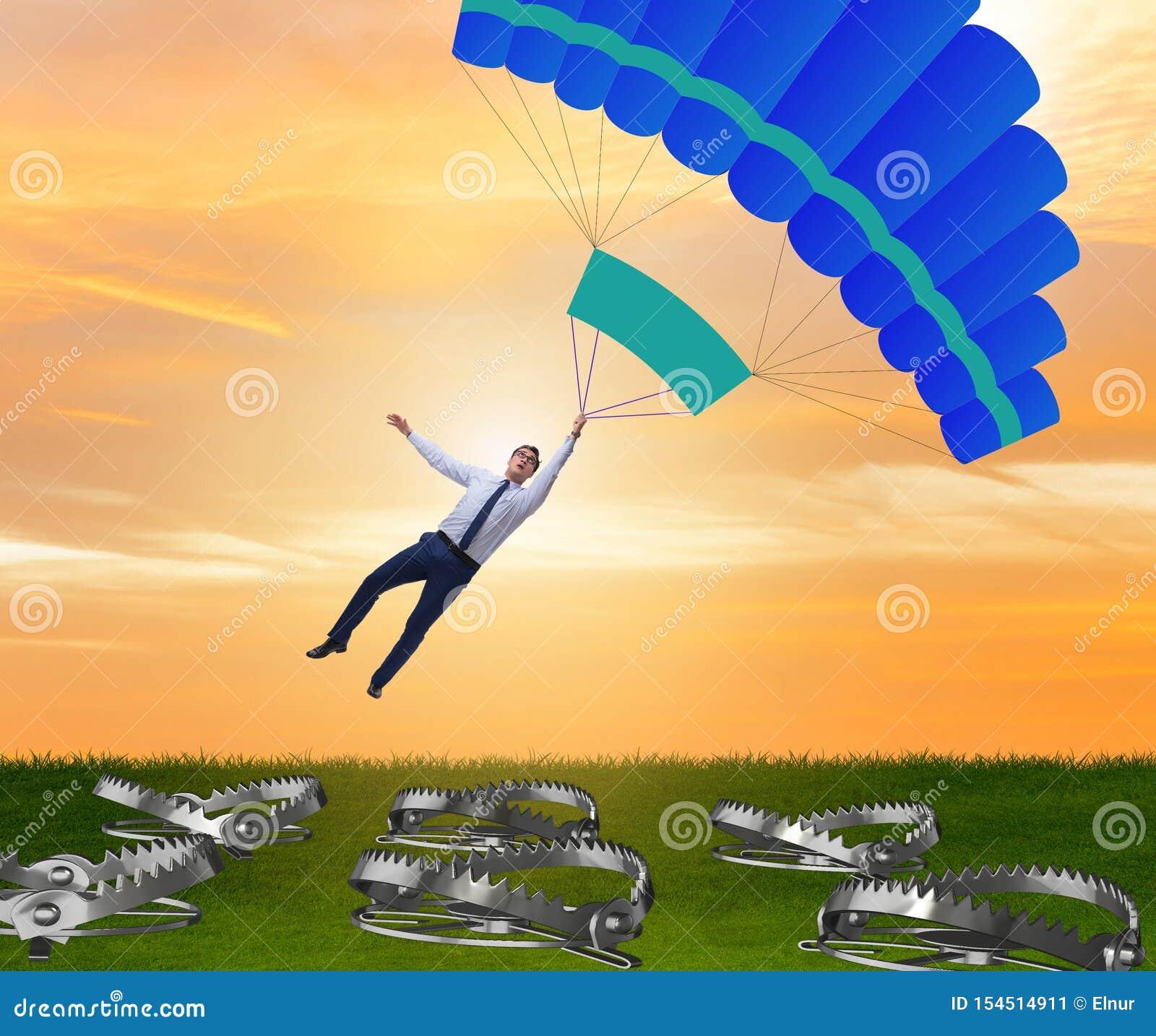 Hombre de negocios que cae en trampa en el paraca?das