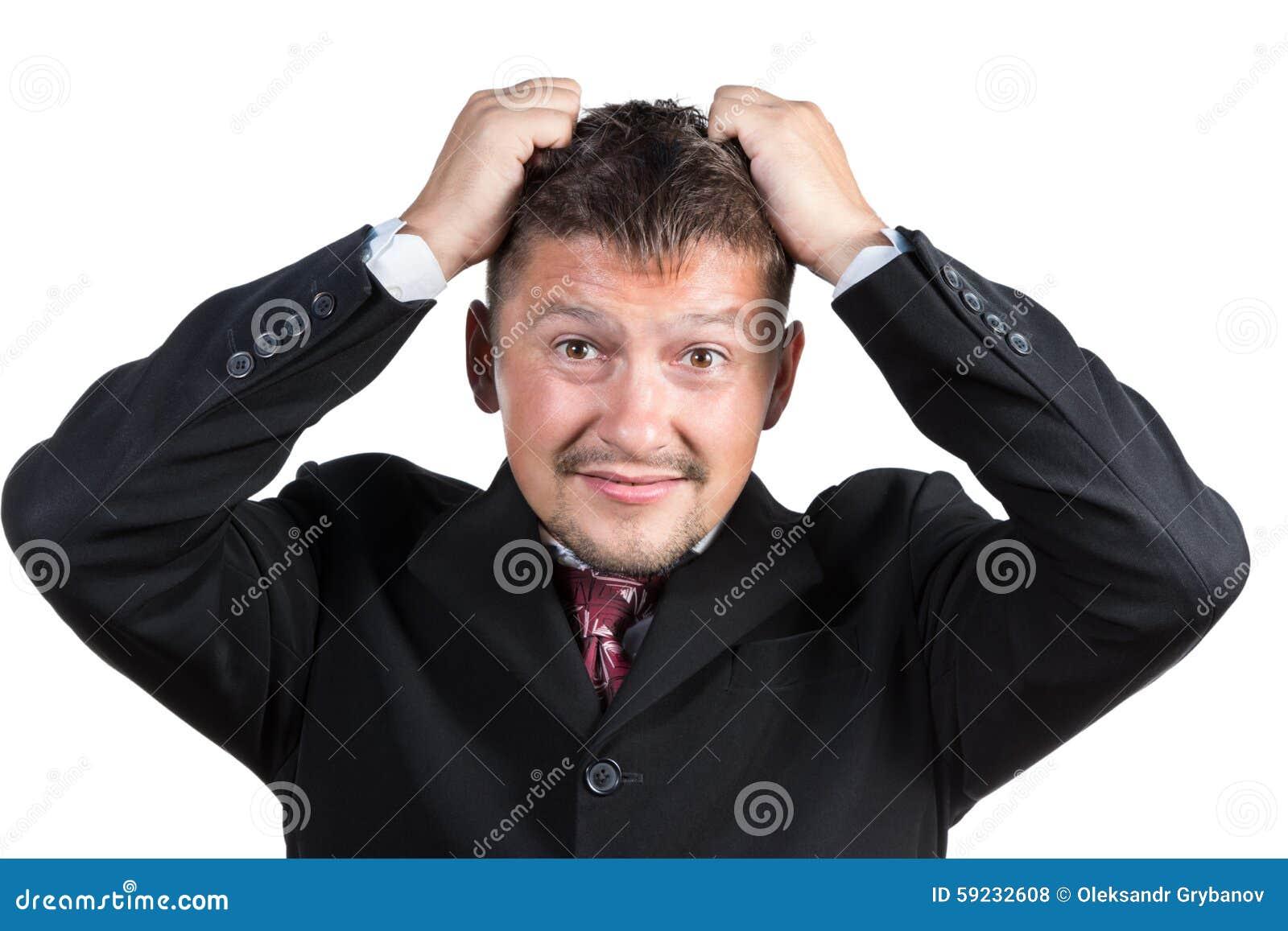 Hombre de negocios que rasga su pelo