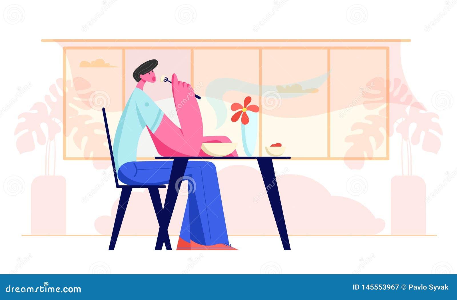 Hombre joven que se sienta en la tabla en restaurante o el caf? que tiene comida Car?cter masculino hambriento que come la comida
