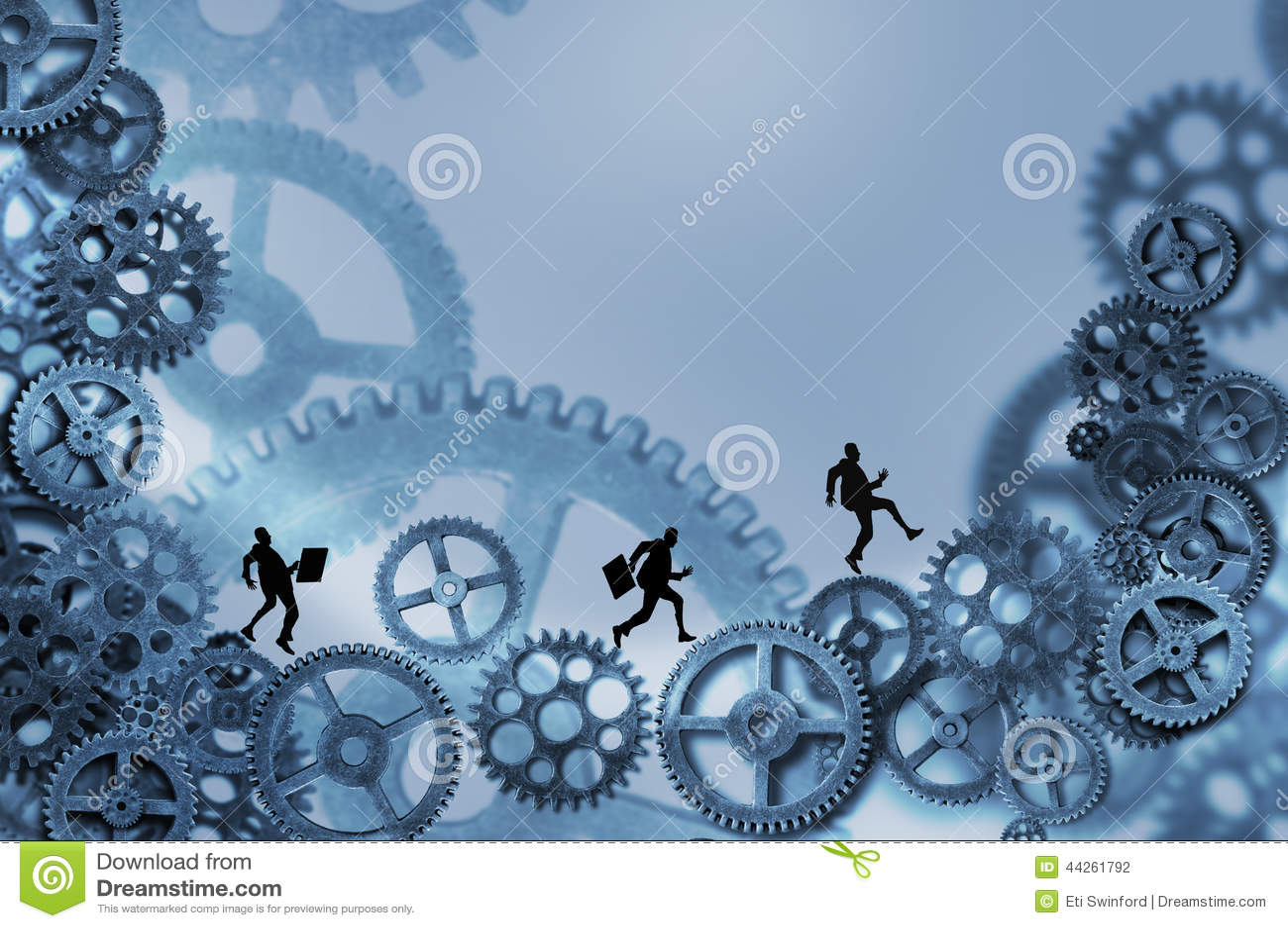 Hombres de negocios que corren en los engranajes