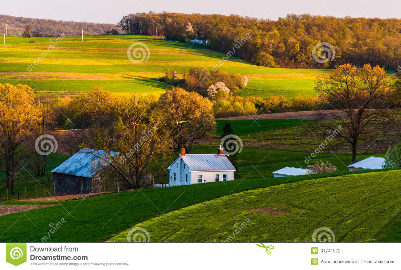 Home And Barn On The Farm Fields And Rolling Hills Of