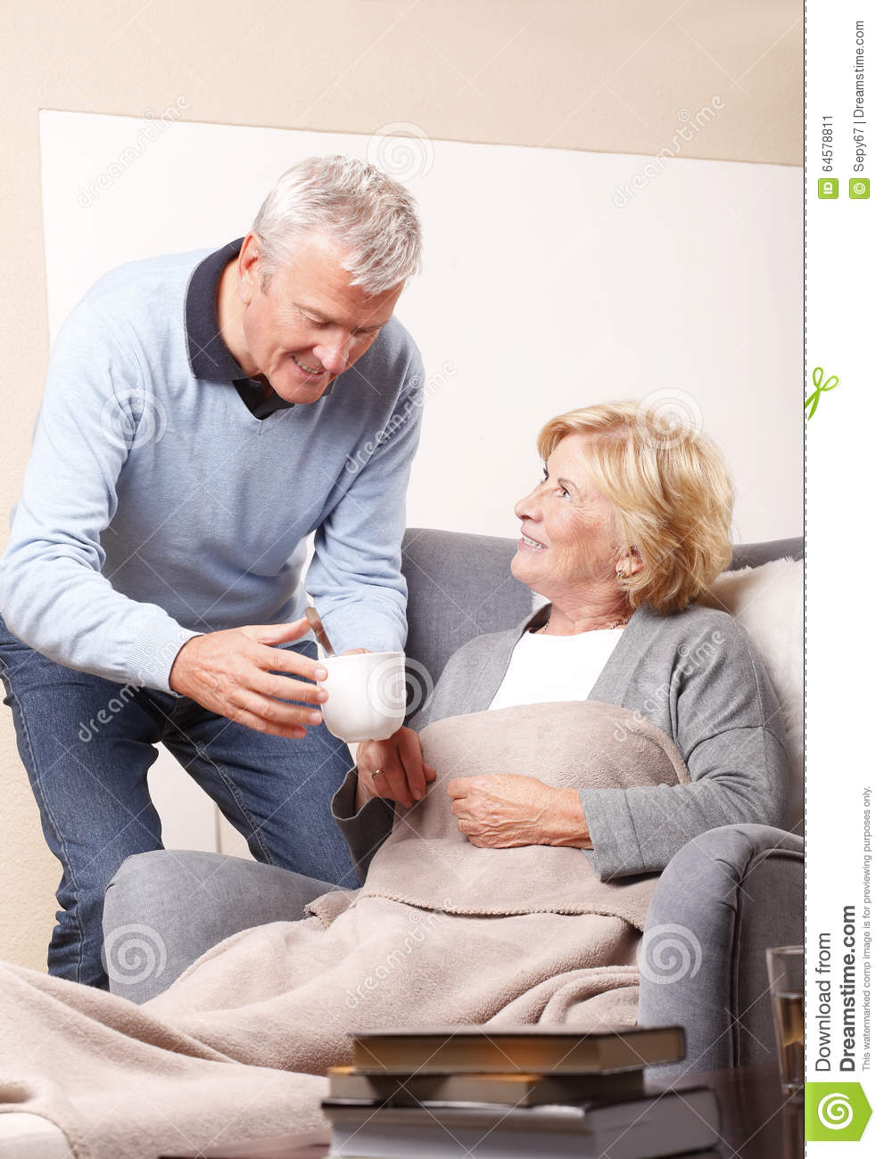 home caregiver and senior patient stock photo