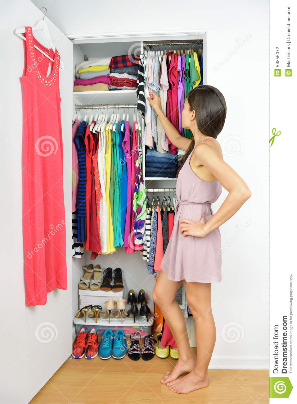 Home closet woman choosing her fashion clothing stock Shopping for home