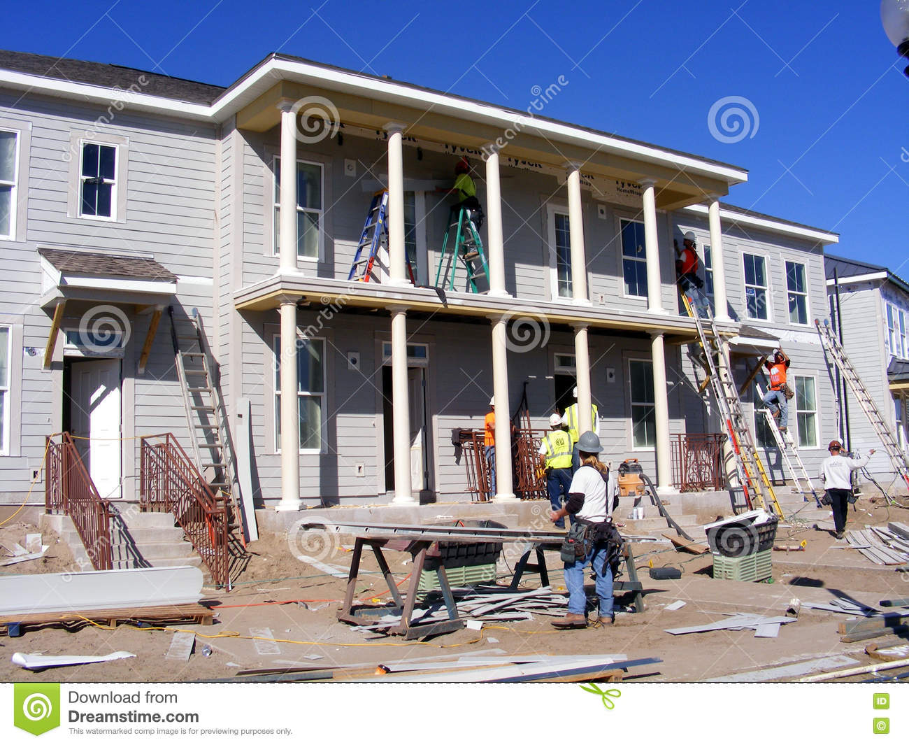 New home construction busy work site editorial image for Home building sites