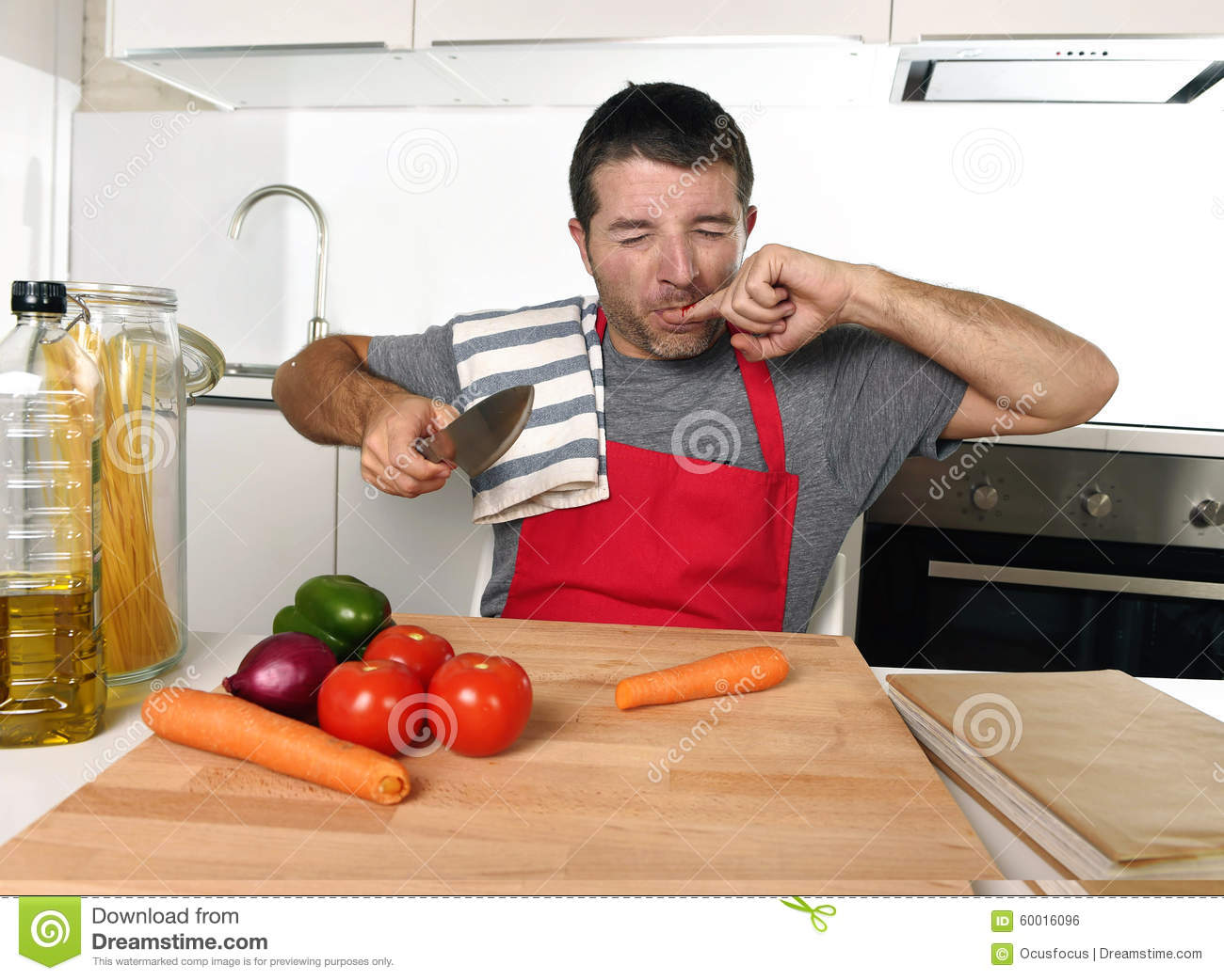 Home Cook Man In Red Apron Slicing Carrot With Kitchen ...