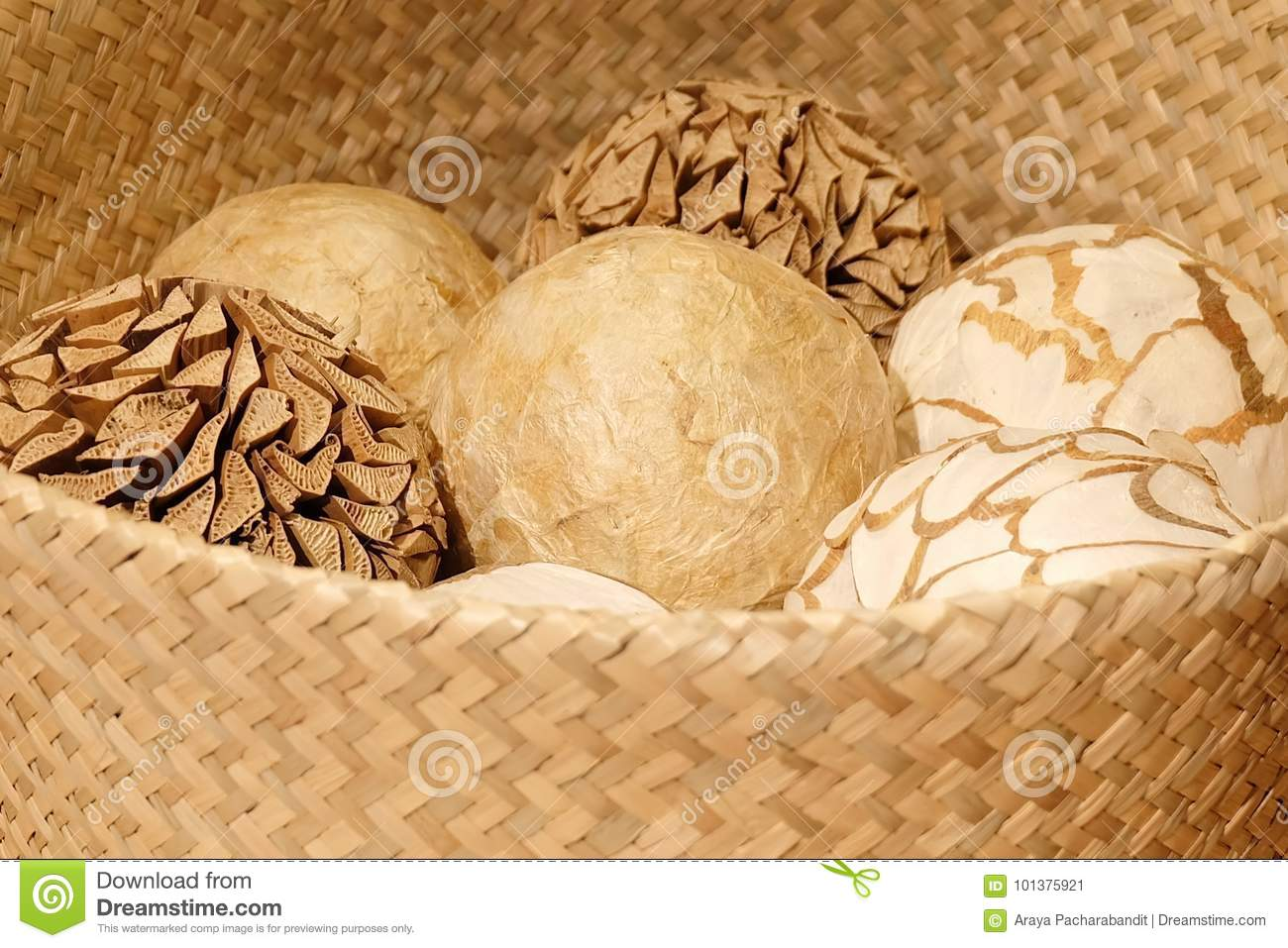 Home Decor Close Up Of Ornamental Decorative Balls In A Woven Wickers Basket Used For Decorating
