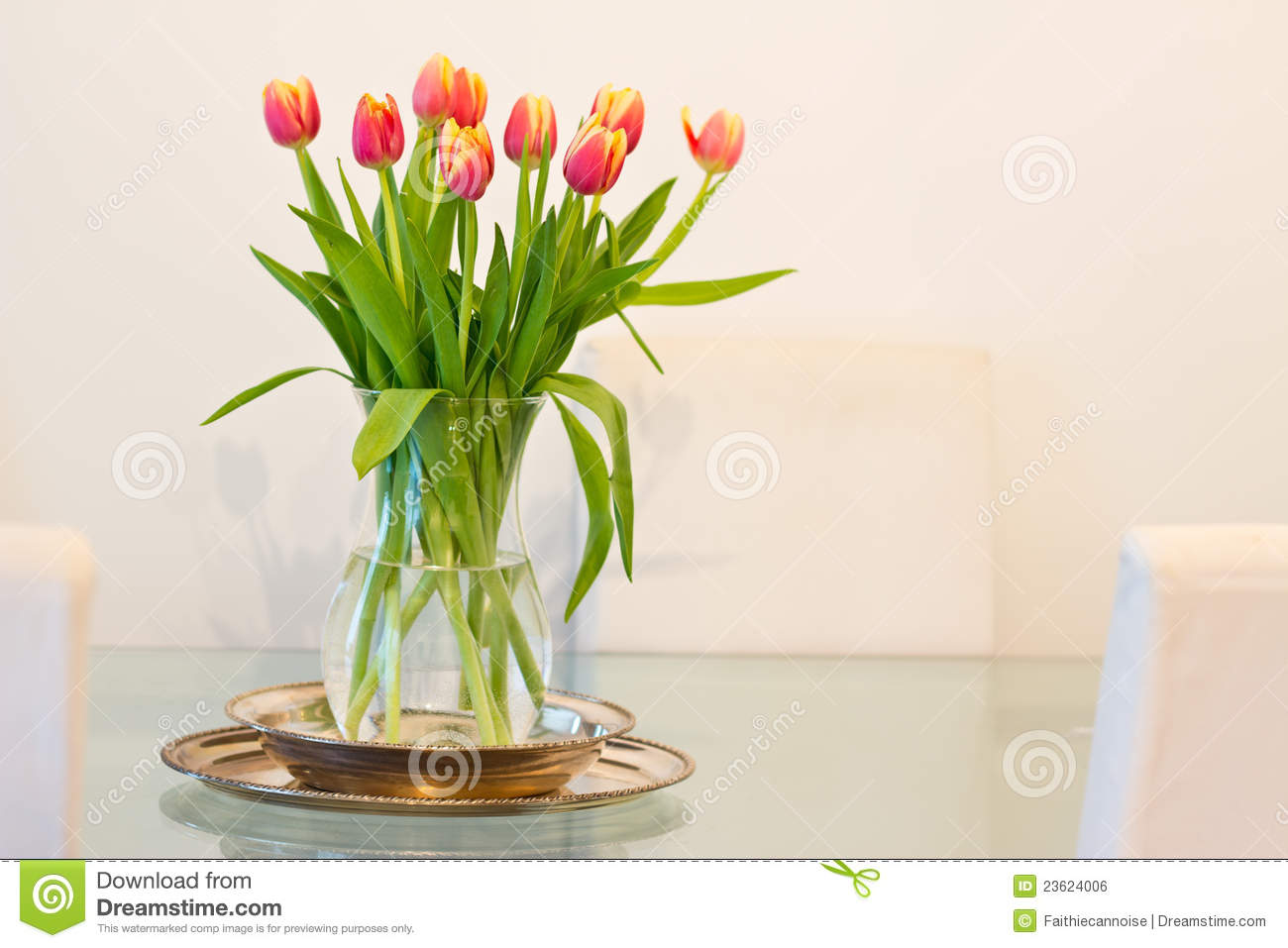 Home decoration vase of tulips on glass table stock photo image home decoration vase of tulips on glass table floridaeventfo Gallery