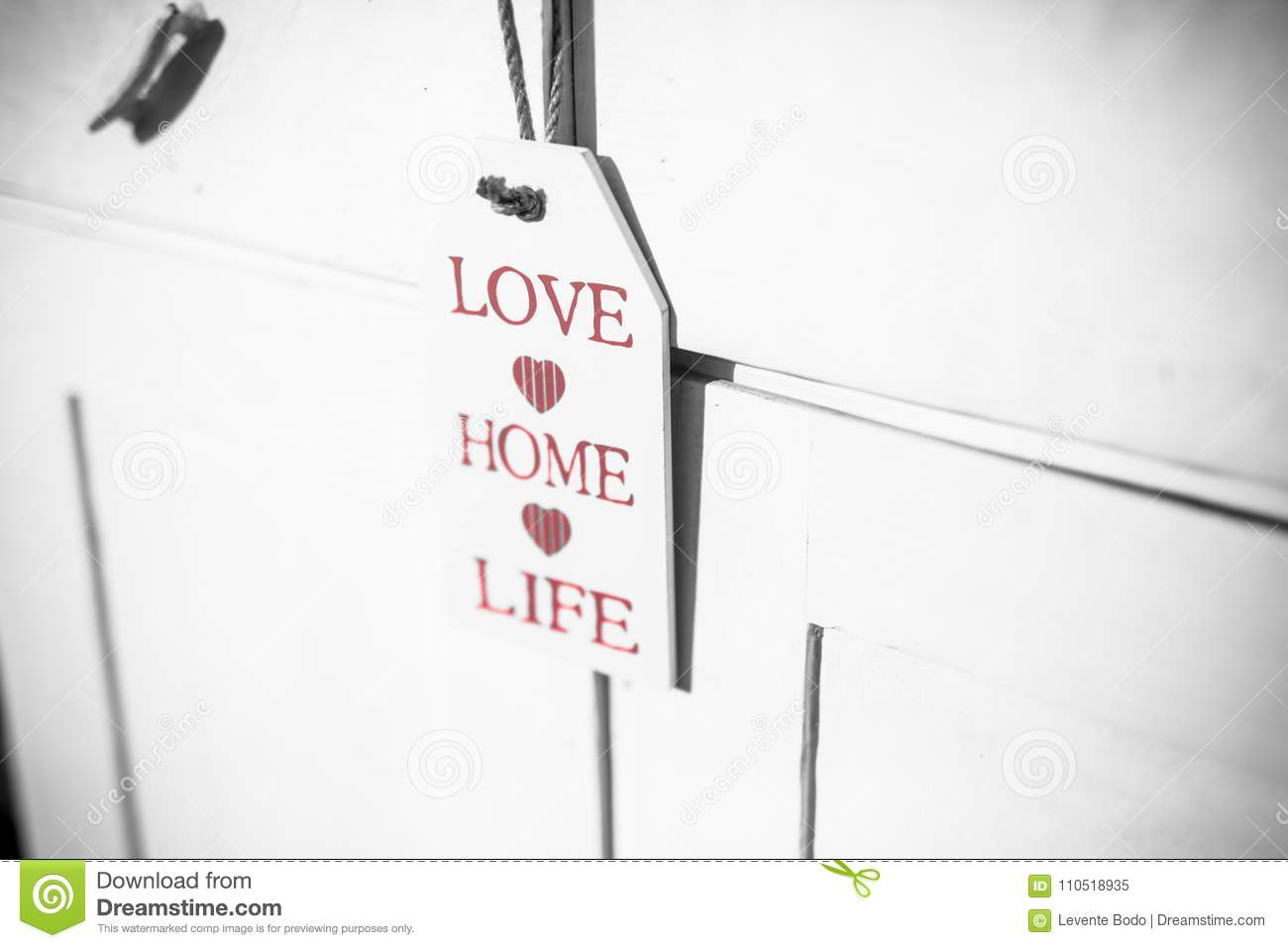Love, home, life sign on wooden ornament and positive thinking wooden plaque
