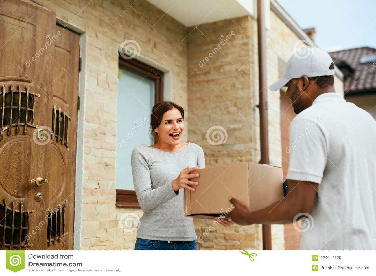 Home Delivery. Courier Delivering Package To Client