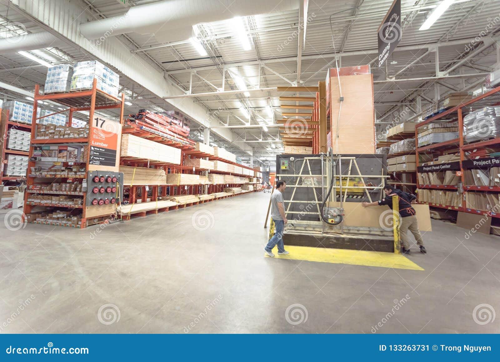 Home Depot Employee Services >> Home Depot Staff Helping Customer Cutting Wood Lumber