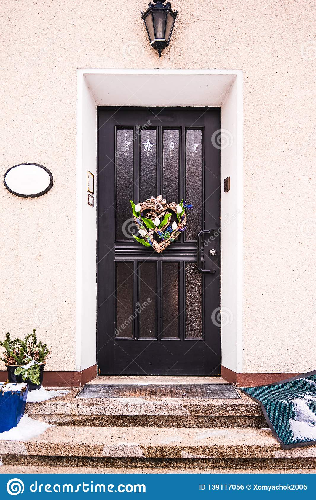 Home Entrance With Decorative Wreath On Front Door Stock Photo Image Of Decorative Floral 139117056