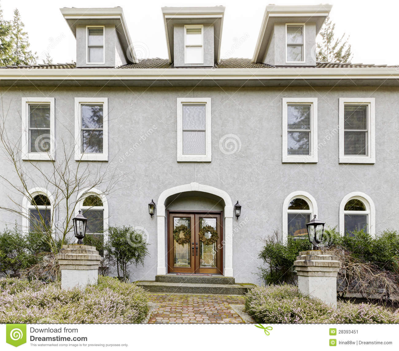 Home exterior of large grey classic house with many narrow for Classic house exterior design