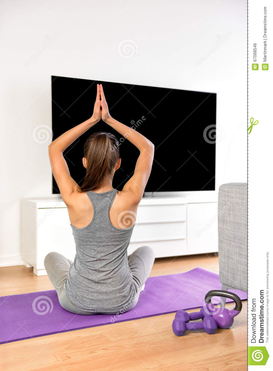 Home fitness woman doing yoga exercise watching tv stock for Living room yoga sessions