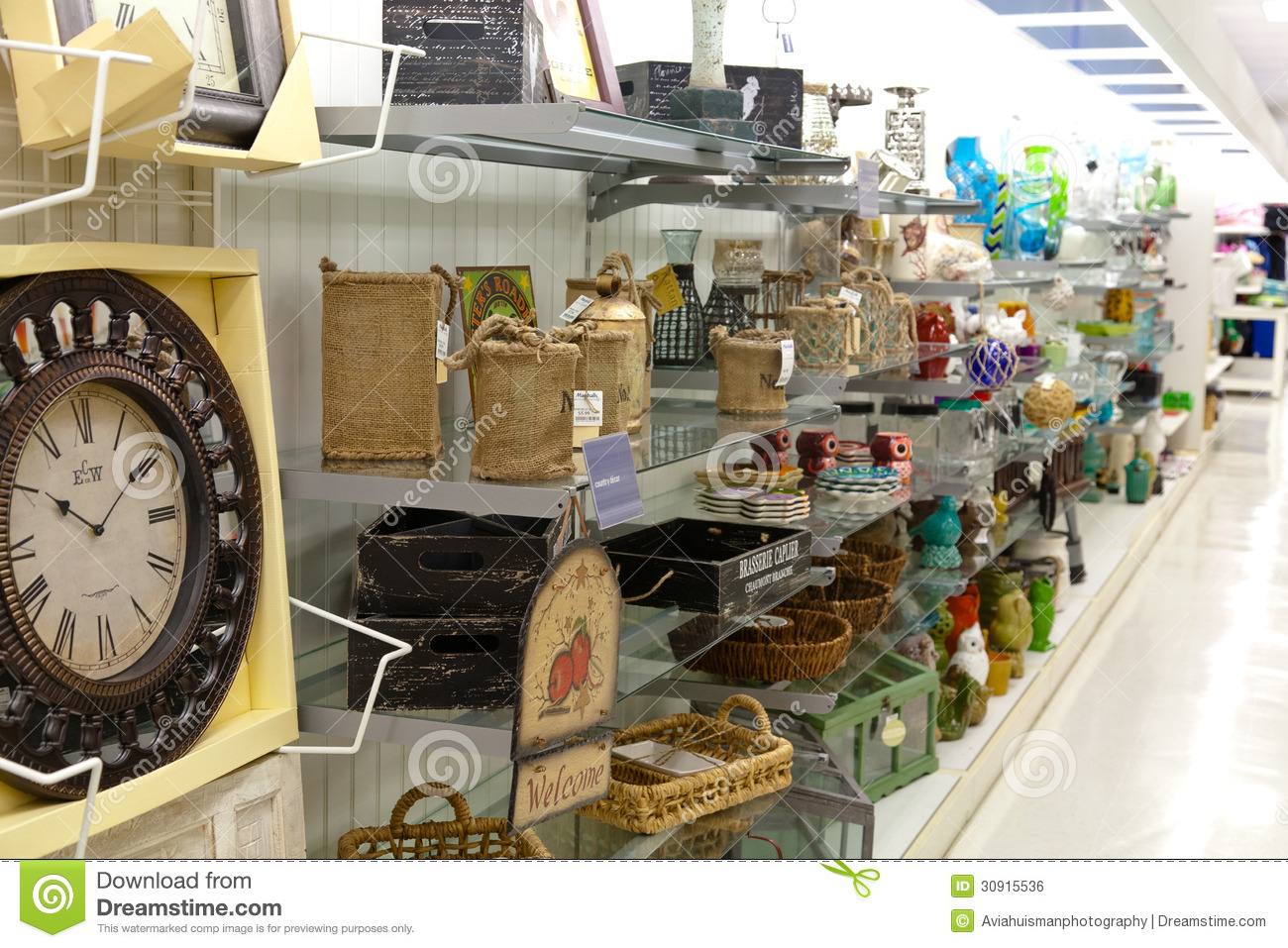Home goods shelves with home decoration products for Decoration goods