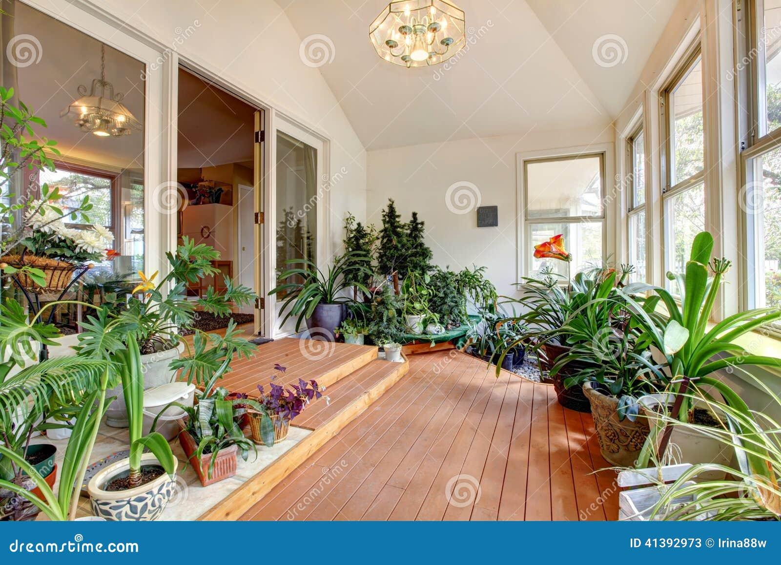 Home Greenhouse Interior Bright High Vaulted Ceiling Hardwood Floor Room Full Plants Blooming Flowers