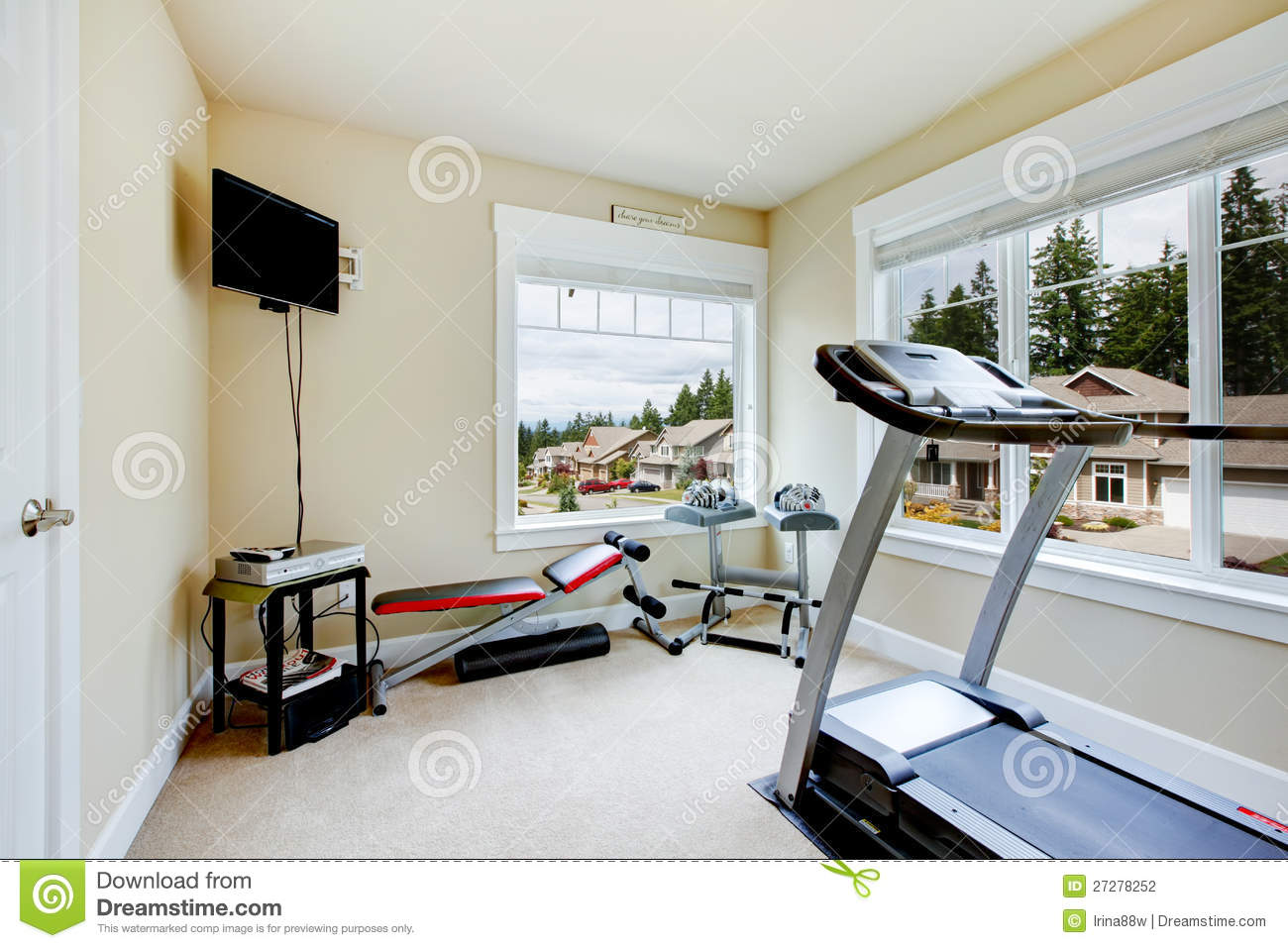 Home gym with equipment weights and tv. stock photo image of room