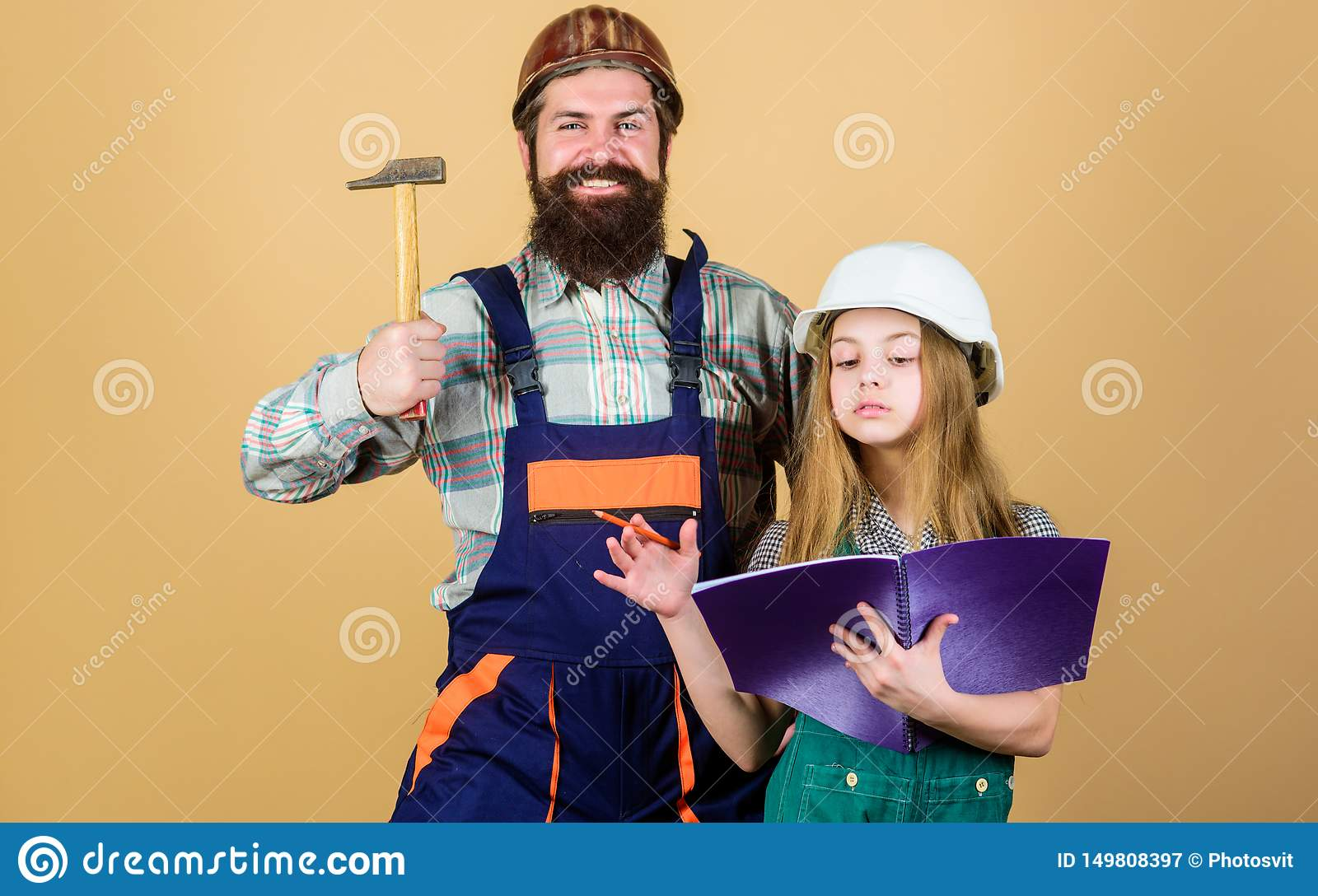 Home improvement activity. Kid girl planning renovation. Child renovation room. Family remodeling house. Little fathers