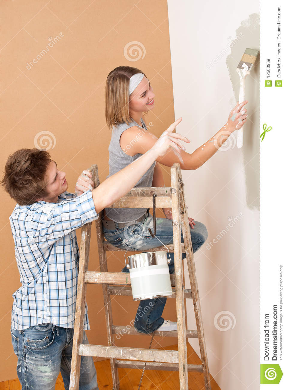 Home Improvement Young Couple Painting Wall Royalty Free