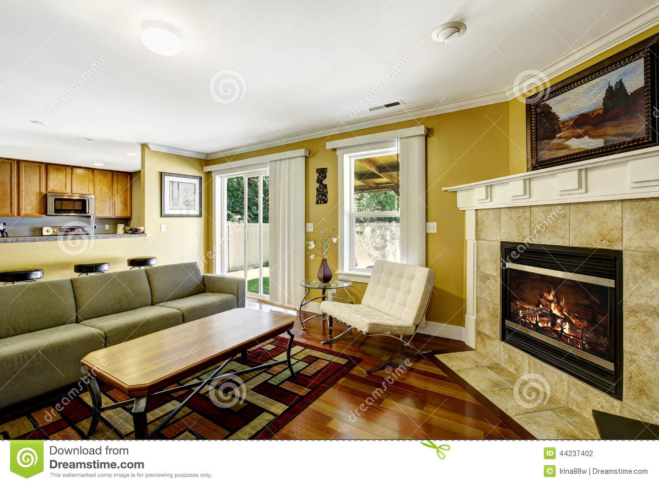 Mustard Living Room Home Interior With Mustard Walls And Green Couch Stock Photo
