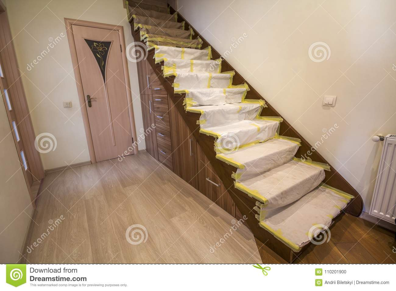 Download Home Interior With Wooden Oak Staircase Covered With Protective  Cloth Cover During Renovation Works.