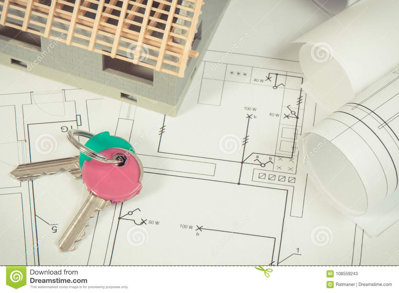 home keys, house under construction and electrical diagrams for engineer  jobs, building home concept