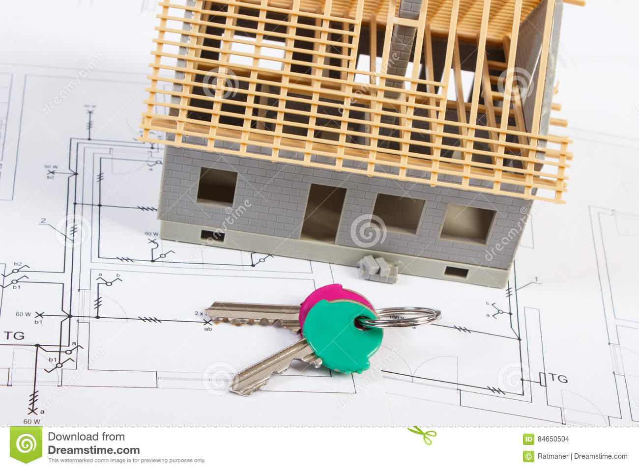 Home Keys And Small House Under Construction On Electrical Drawings ...