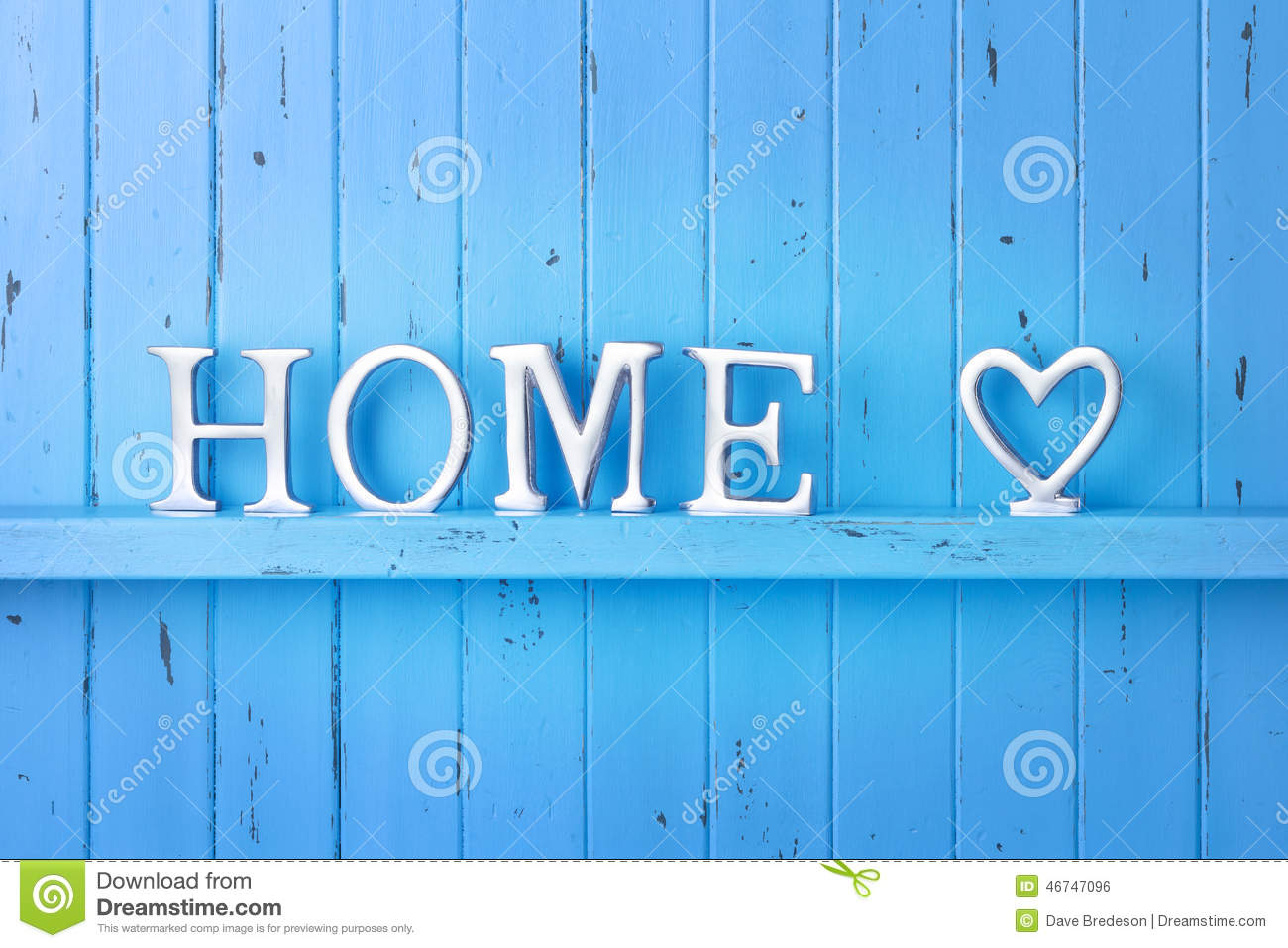 rustic blue painted wood background with the word home spelled out ...