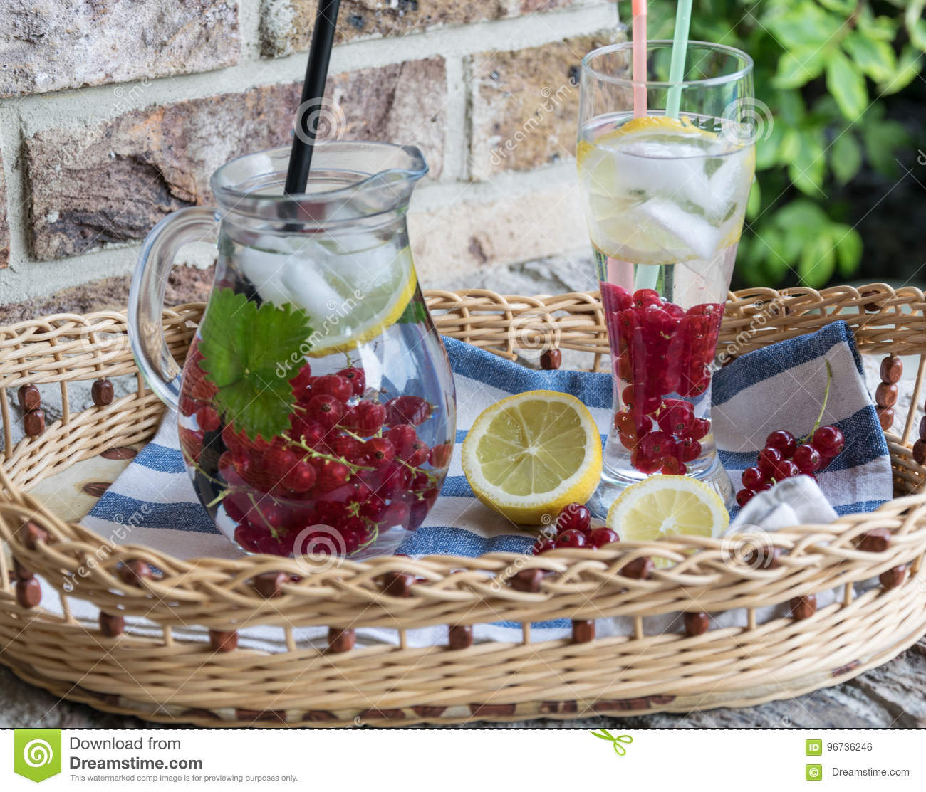 Home-made refreshing lemonade of red currant with ice and lemon