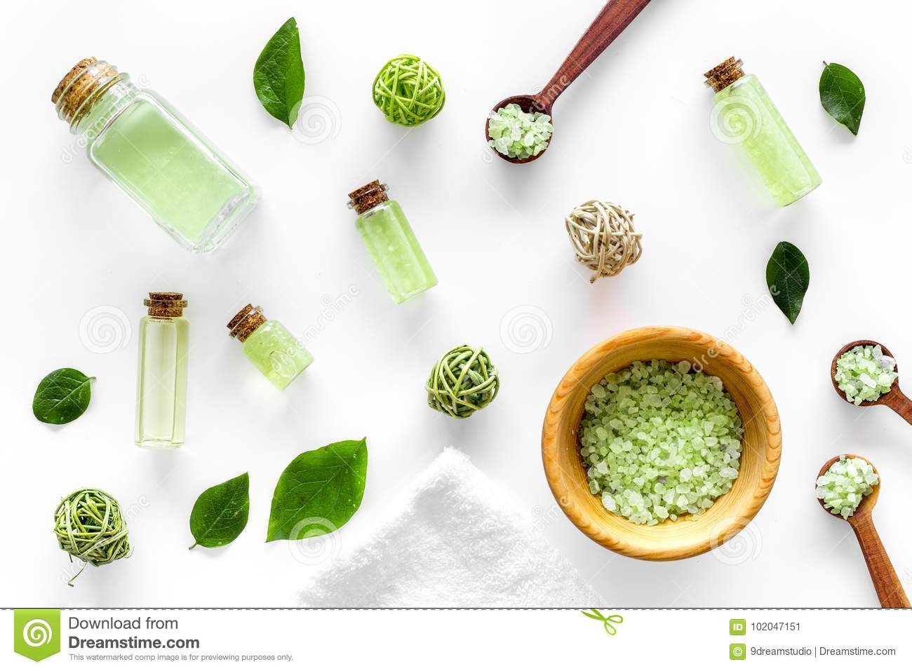 Home made spa cosmetic with tea olive oil and salt for bath on white background top view pattern
