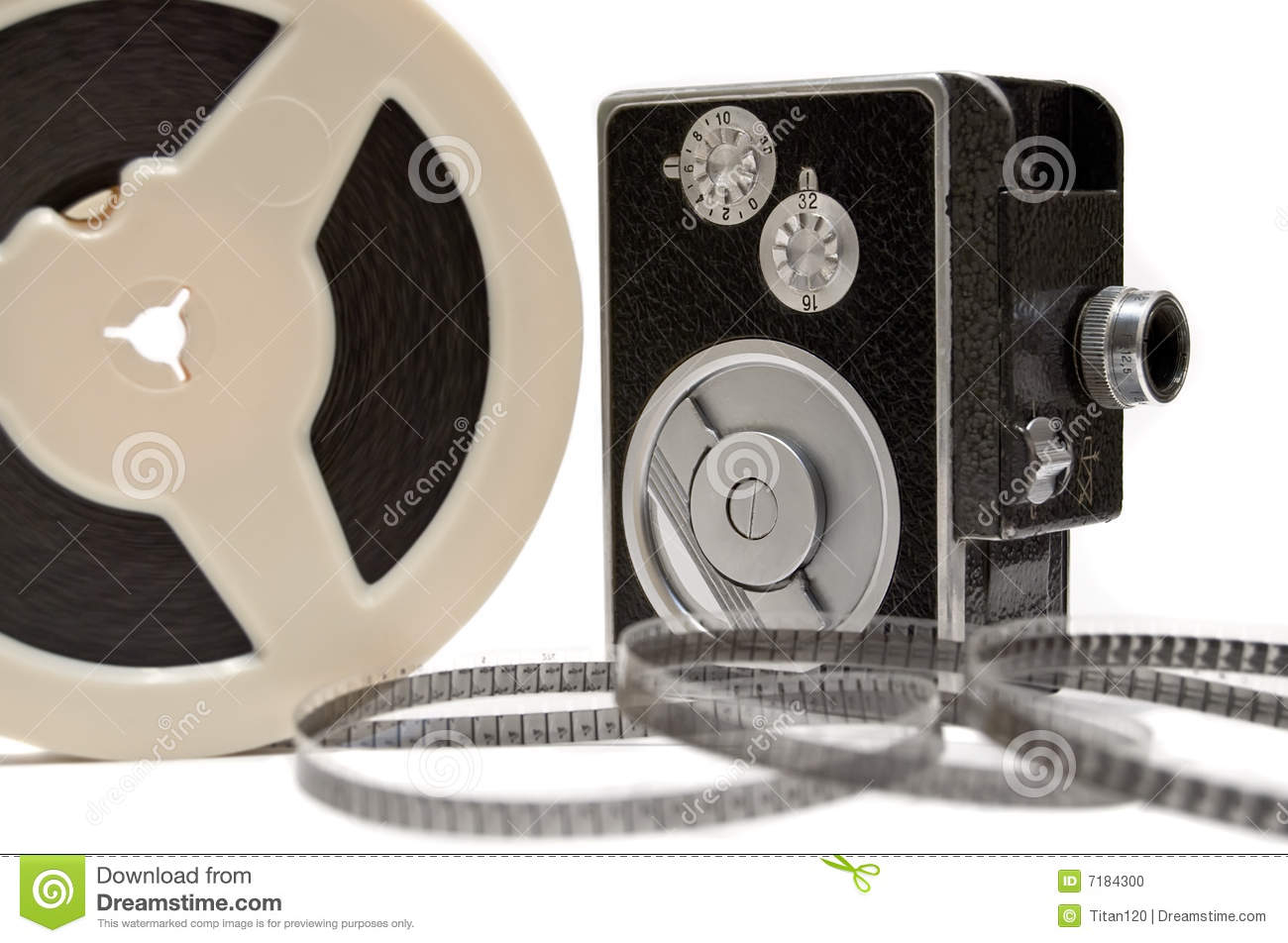 home movie camera and film reel isolated on white stock