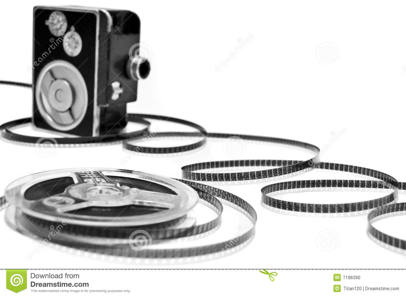 Home movie camera and film reel isolated on white